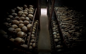 The skulls and bones of some of those who were slaughtered as they sought refuge inside the church, are laid out on shelves in an underground vault as a memorial to the thousands who were killed in and around the Catholic church during the 1994 genocide in Nyamata, Rwanda, Friday, April 4, 2014. The country will commemorate on April 7, 2014 the 20th anniversary of the genocide when ethnic Hutu extremists killed neighbors, friends and family during a three-month rampage of violence aimed at ethnic Tutsis and some moderate Hutus, leaving a death toll that Rwanda puts at 1,000,050. (AP Photo/Ben Curtis)